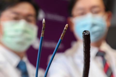 The novel flexible endoscopic robotic platform, consists of two minute robotic arms to achieve tissue retraction and dissection. They are as tiny as green mung beans, Credit: The Chinese University of Hong Kong (CUHK))